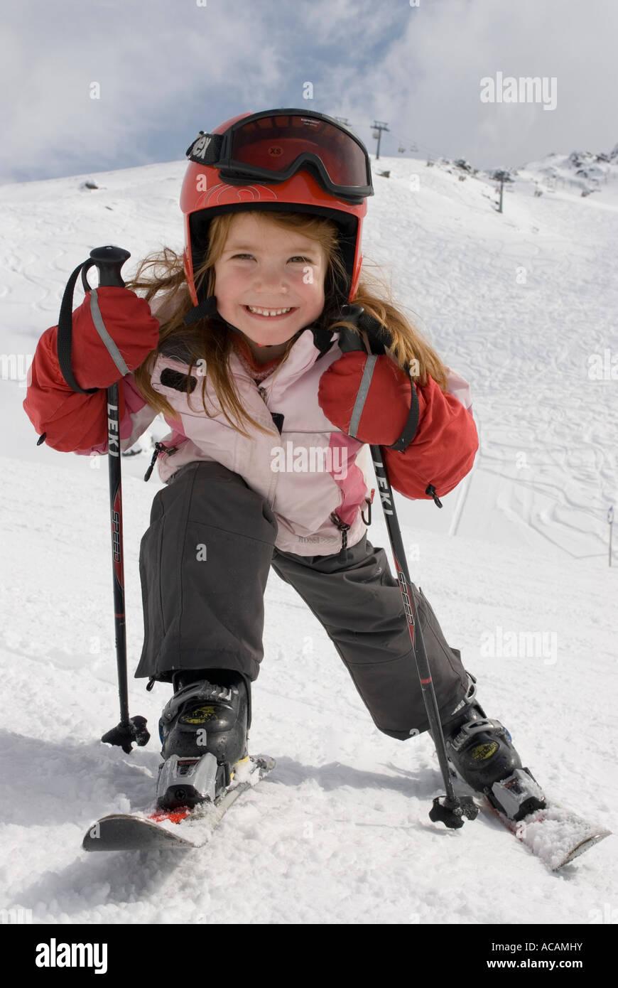 Girl with helmet skiing - Stock Image