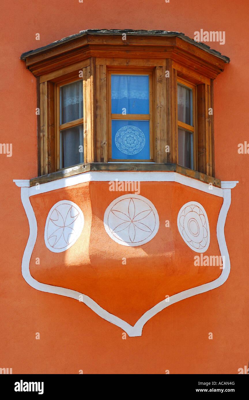 Bay window of traditional Engadine house, S-chanf, Engadin, Grisons, Switzerland Stock Photo