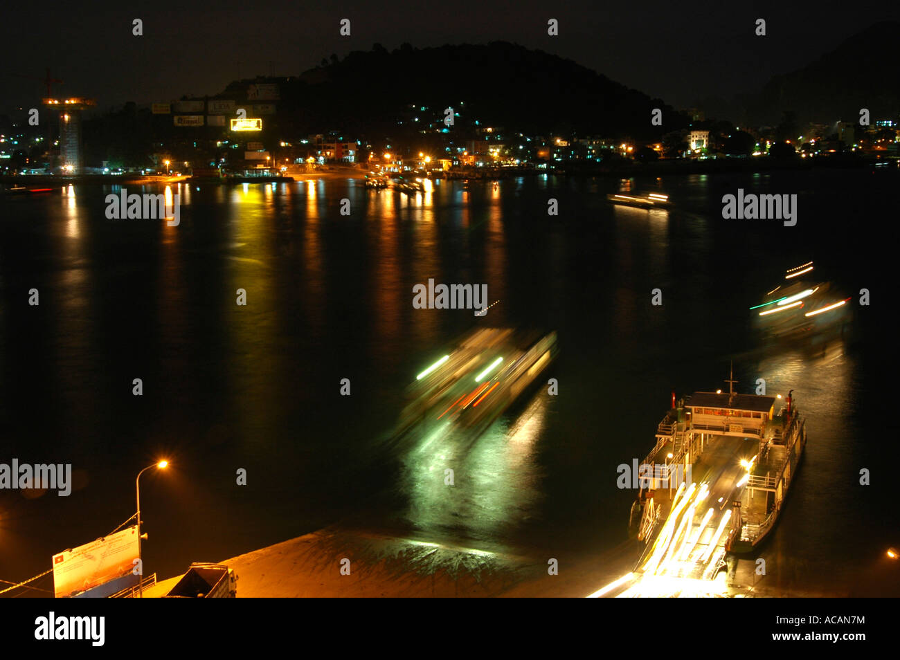 Night ferryboats from Halong City to Hon Gai district, Halong City, Vietnam - Stock Image
