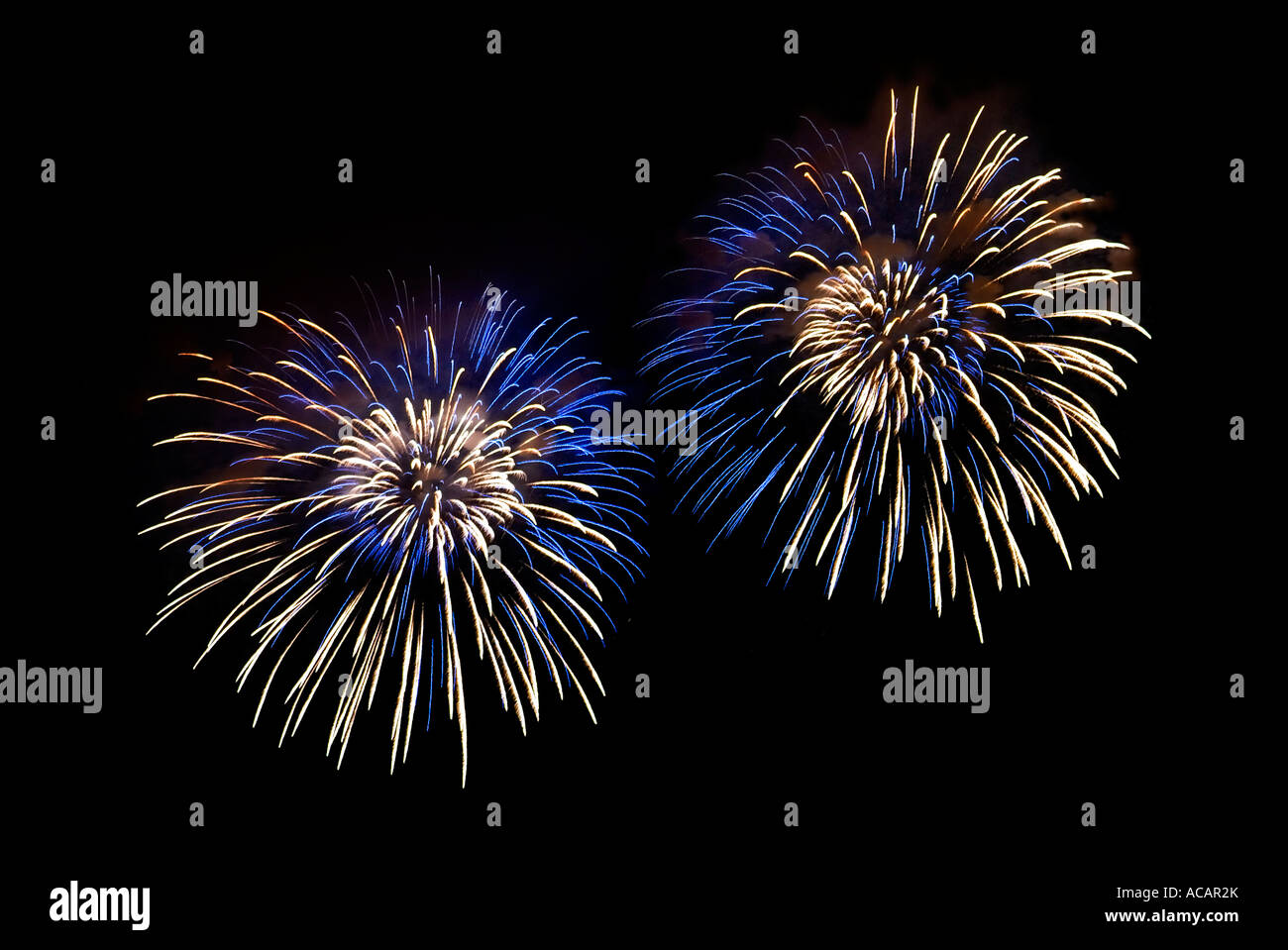 Blue-white light effects in the night skies during the New Year`s Eve fireworks Stock Photo