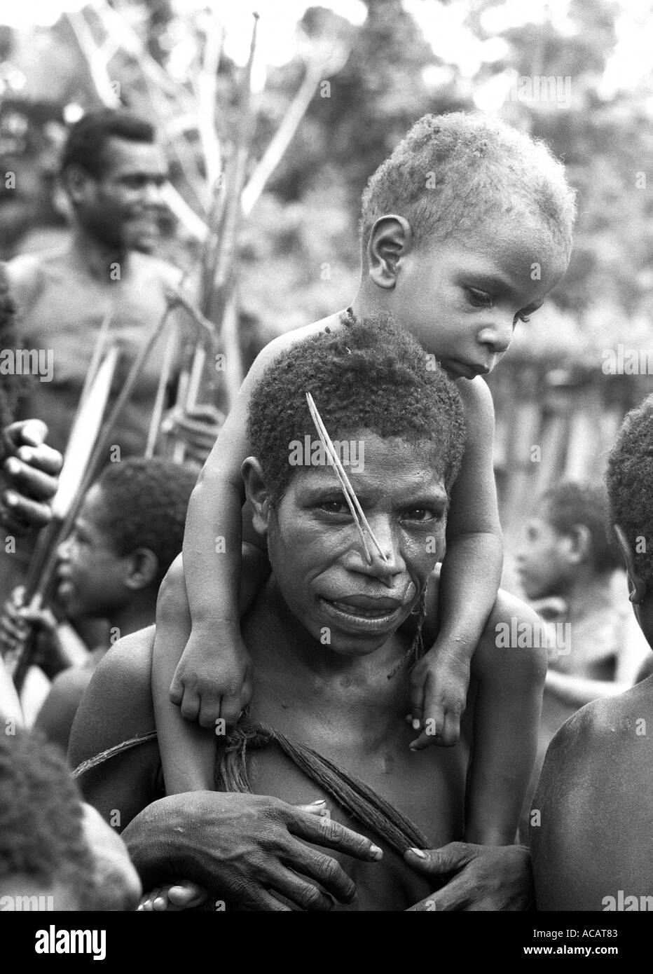 Primitive villagers in then unmapped Irian Jaya (1980), Western New Guinea, Indonesia. - Stock Image