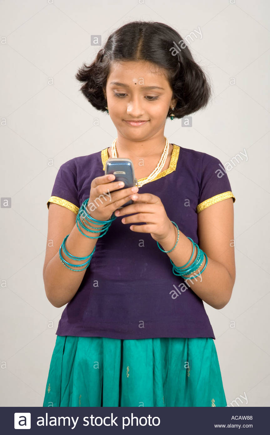 Mak70826 South Asian Indian Girl Reading Sms On Mobile Phone Model Release Number 633