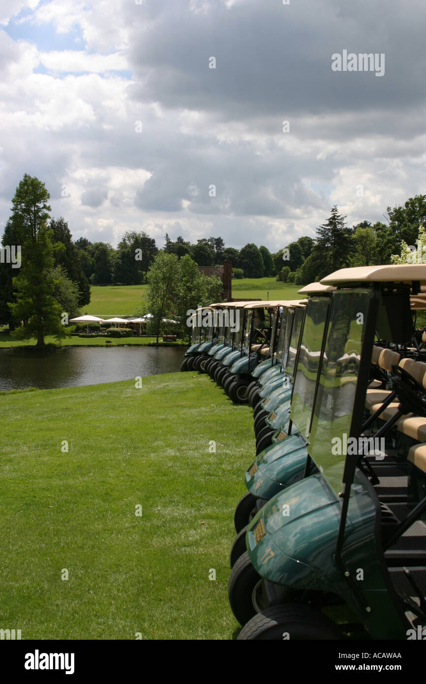 LINE OF GOLF BUGGIES - Stock Image