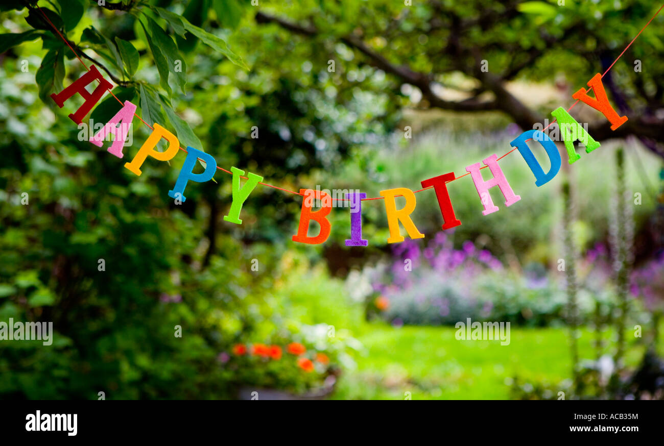 Happy Birthday Sign Hanging In A Garden Stock Photo
