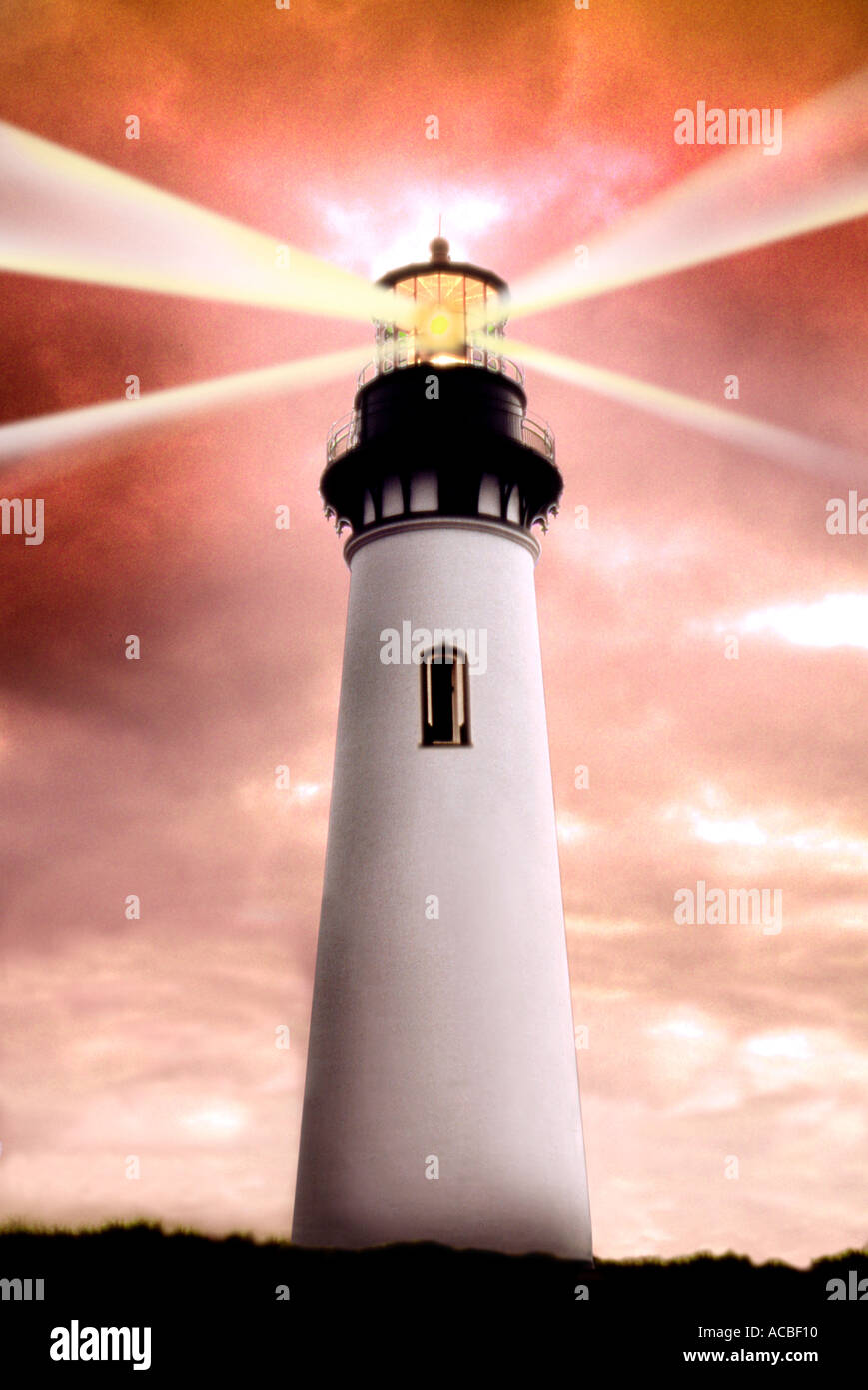 Solitary lighthouse with brightly lit lamp and light beams - Stock Image