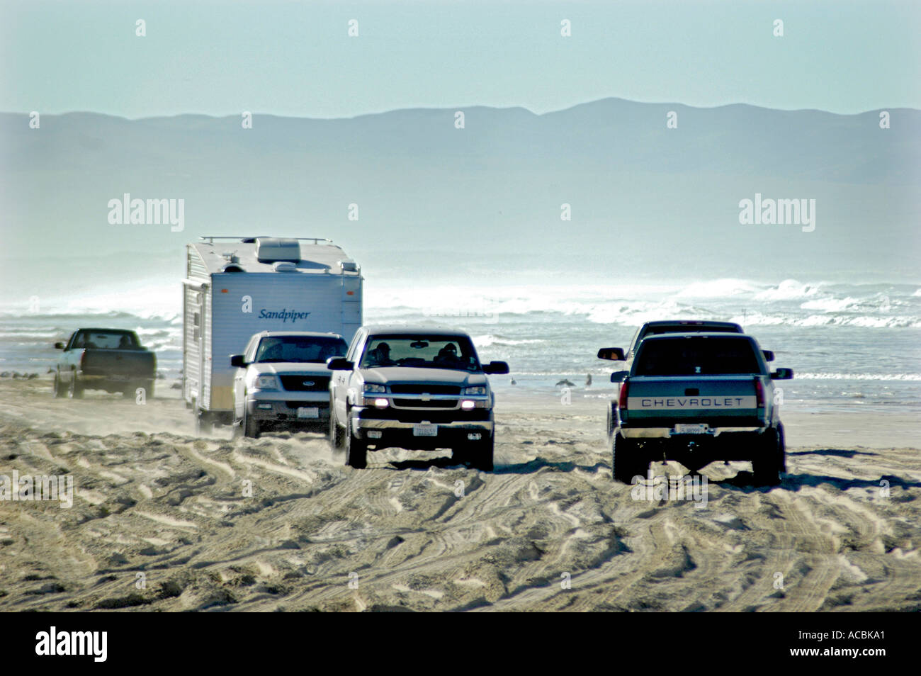vehicles driving beach cars trucks beach