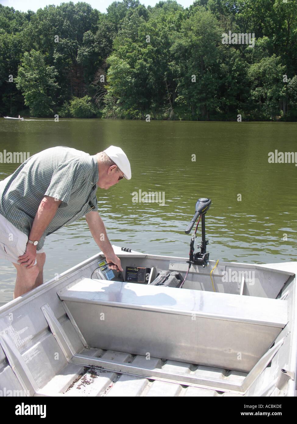 Man Checking Small Boat - Stock Image