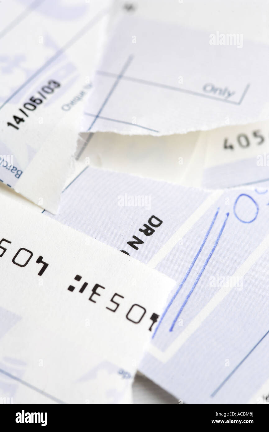 Close up of Bank cheque check torn up - Stock Image