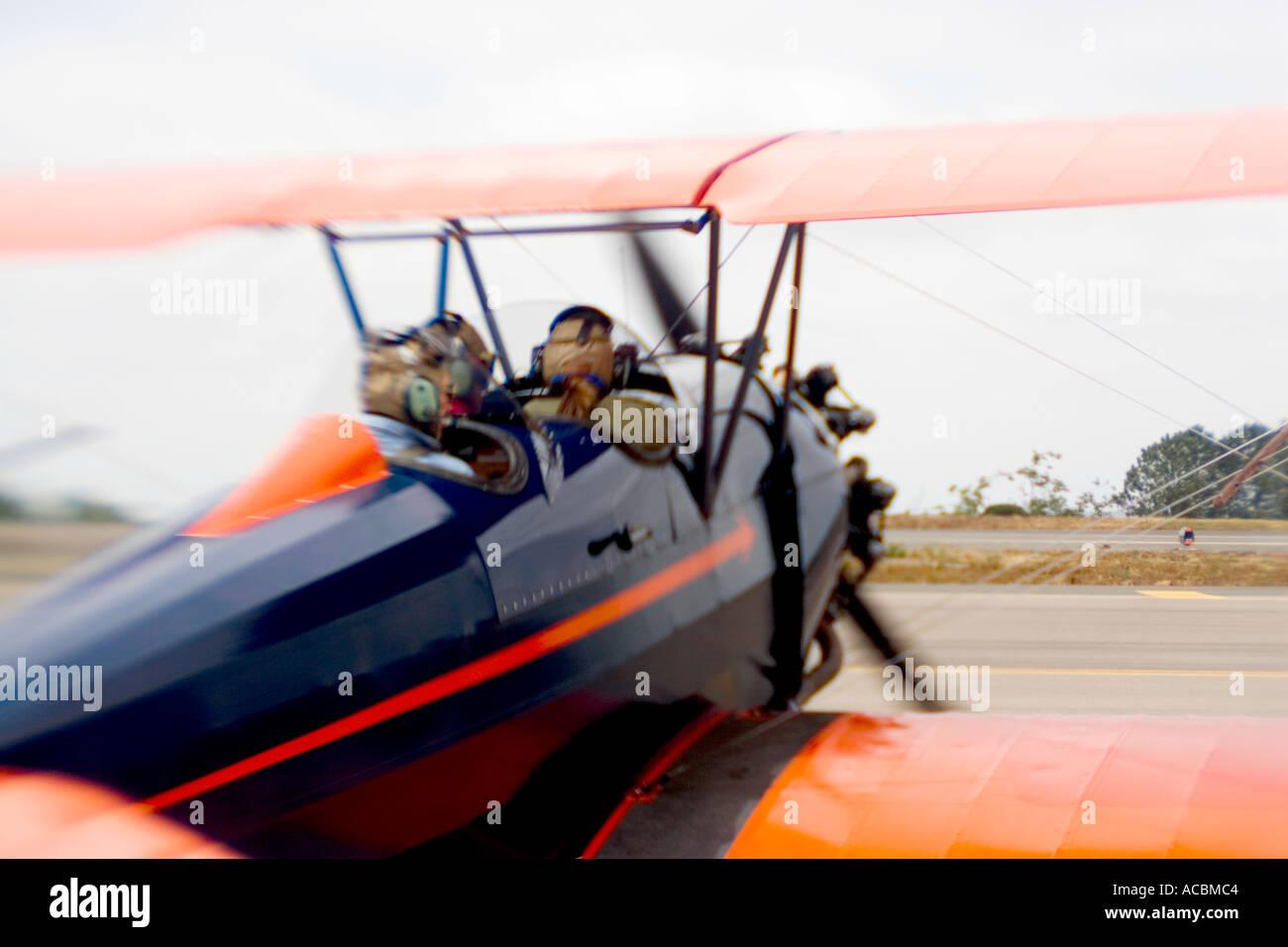 Old Bi plane on tarmac waiting to take off - Stock Image