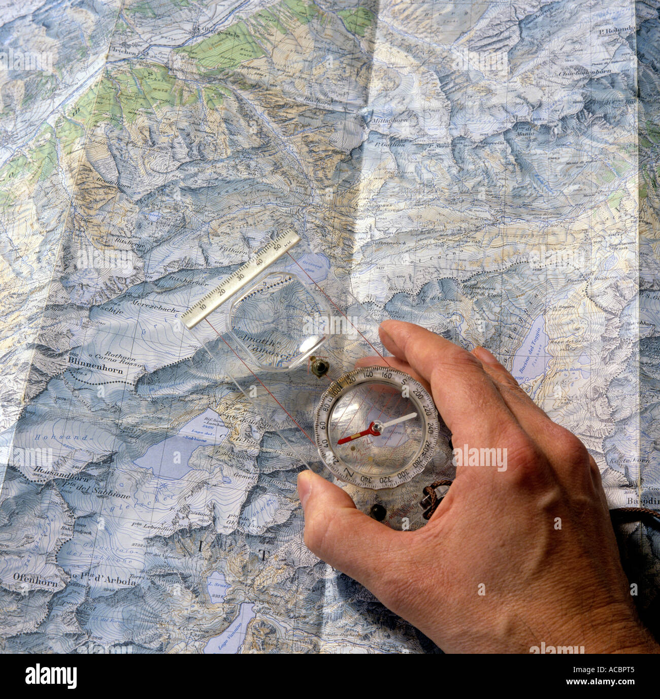 compass and map for planning mountain trip round mount blinnenhorn swiss alpes canton of valais switzerland editorial - Stock Image