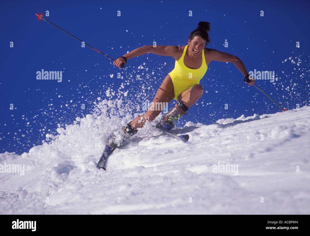 Woman spring skiing in swimsuit Whistler Mountain Whistler British Columbia Canada - Stock Image
