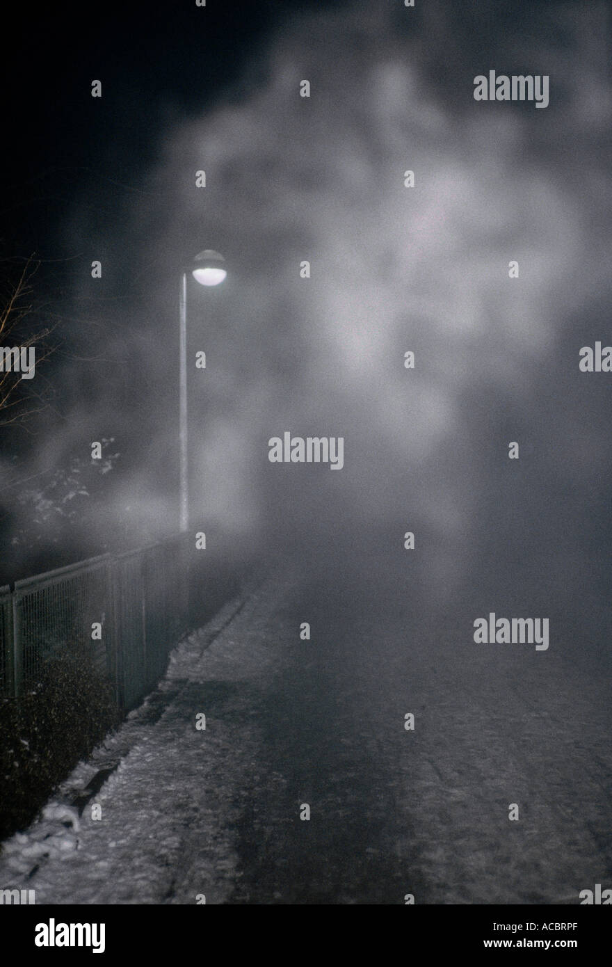 lantern shining through waft of mist - Stock Image