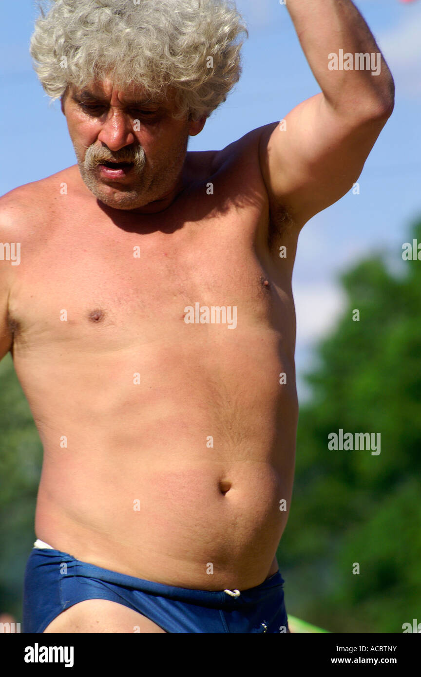 Old man dancing at rave party in knickers, drunk - Stock Image