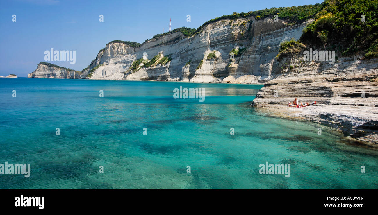 Corfu Island Peroulades Cape Drastis panoramic view from Longas beach coastline cristal clear water - Stock Image