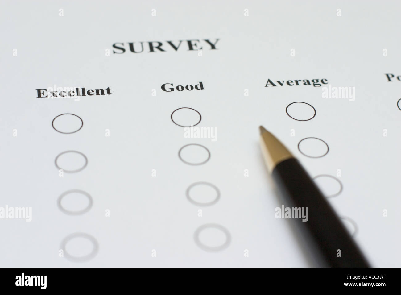 pen on survey form with the words excellent good average - Stock Image