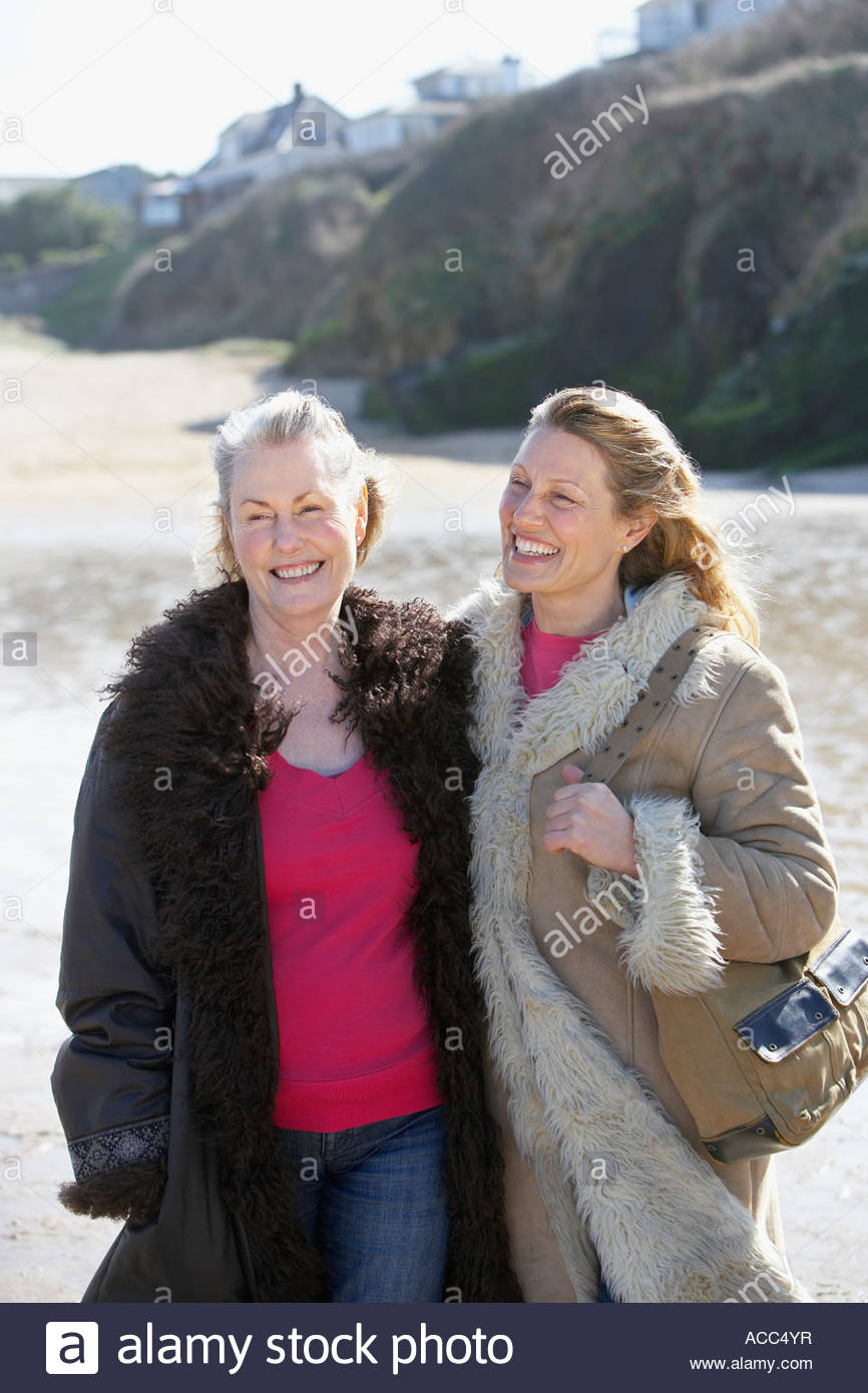 one mature and one senior woman on the beach - Stock Image
