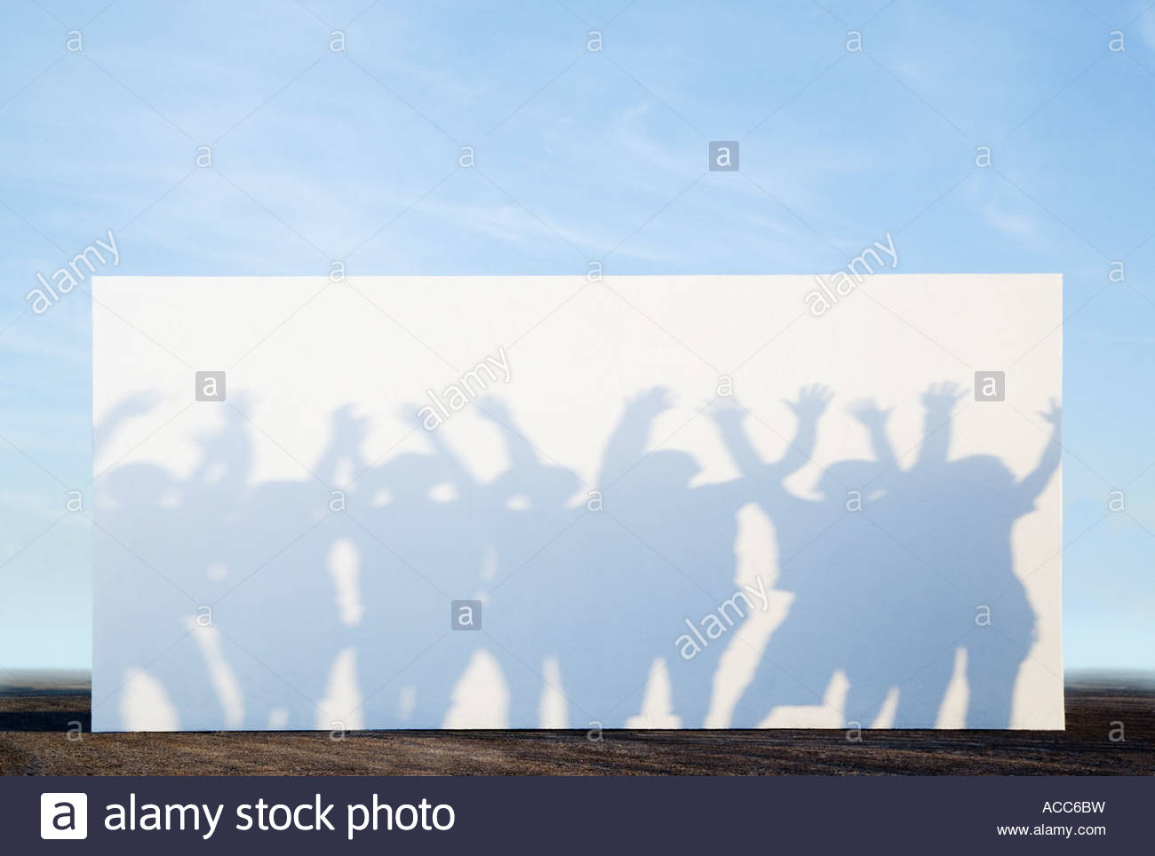 Silhouette shadows of people on a billboard - Stock Image