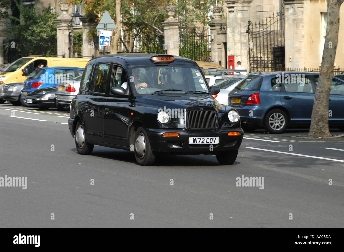 Traditional black taxi hackney cab London vehicle car in St Giles ...