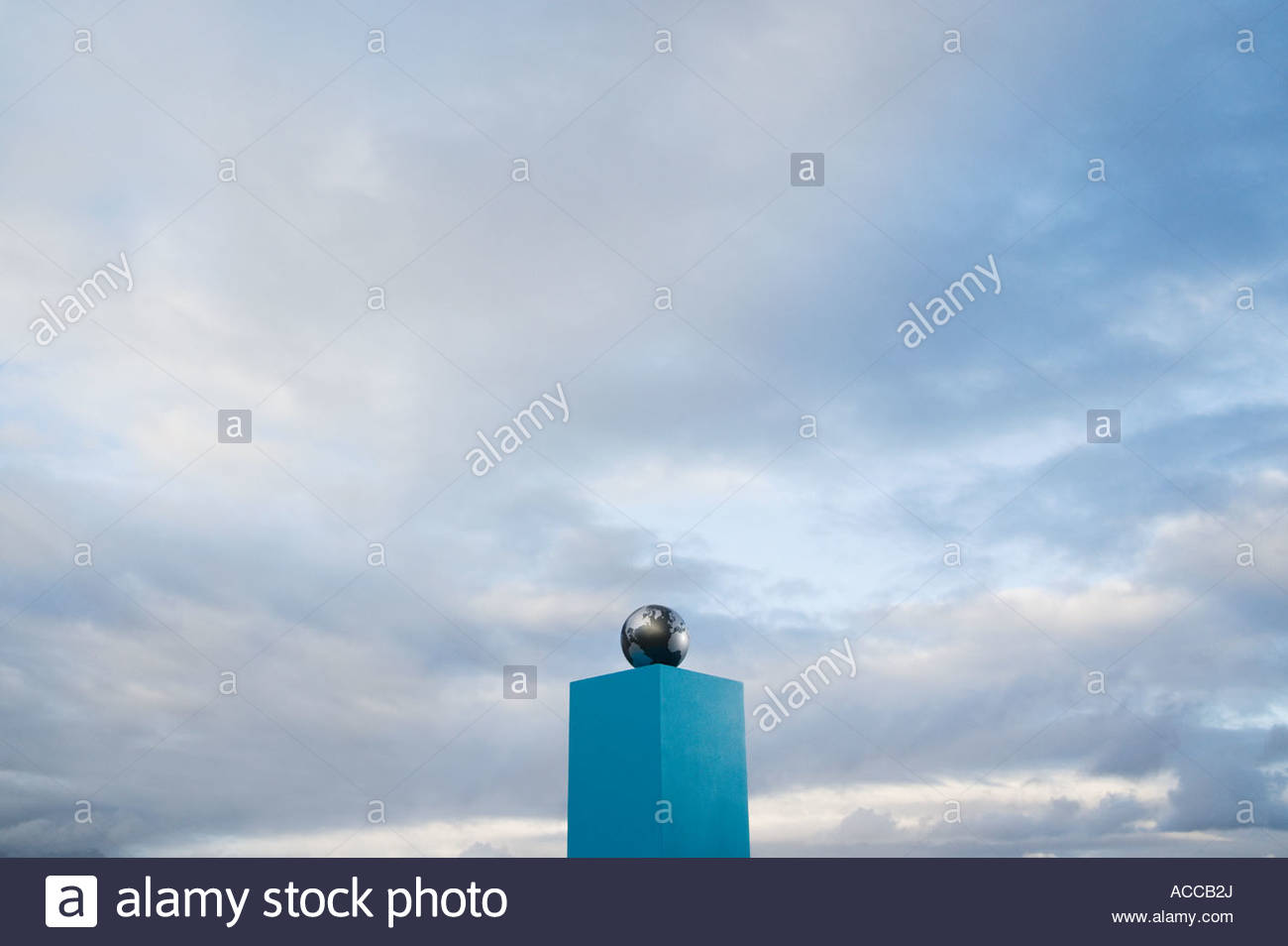 Globe on pedestal outdoors - Stock Image