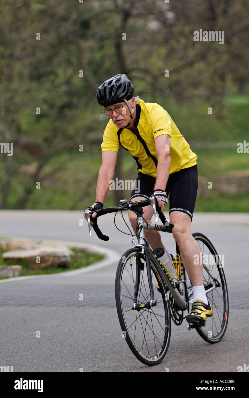 Older Man Riding Bike through Park Cherokee Park Louisville