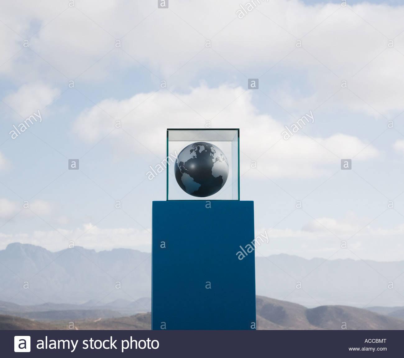 Globe in glass box on pedestal - Stock Image
