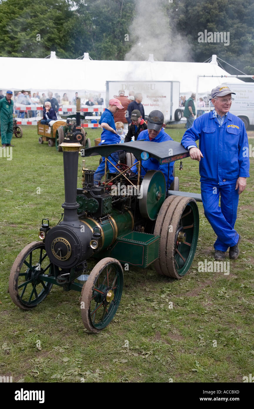 Proud owners of operating scale model traction engine at a steam fair Bayley Park Abergavenny Wales UK - Stock Image