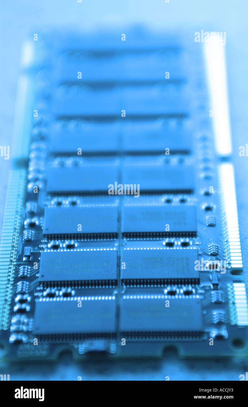 the inside workings of a computer including memory chips and other components - Stock Image