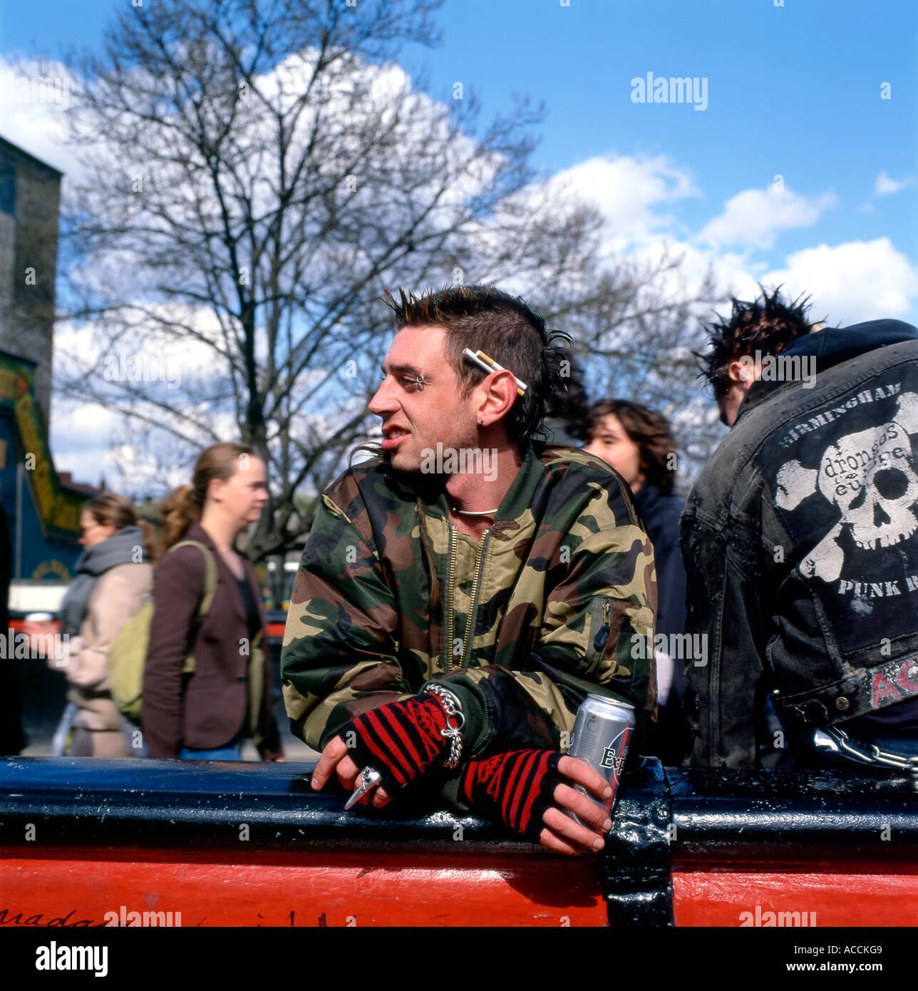 Punk man with beer can at Camden Lock London England UK - Stock Image