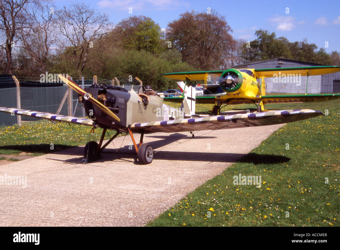 eechcraft D17 Staggerwing bi plane and replica Junkers replica at the re fuelling station on Popham Airfield Hampshire Englan - Stock Image