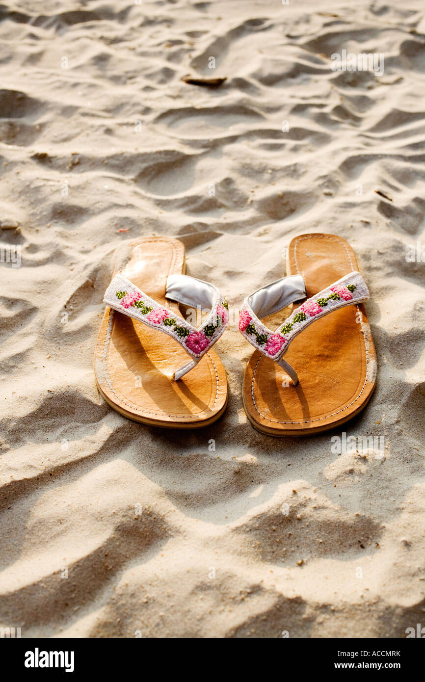 Sandals on a beach close-up. - Stock Image