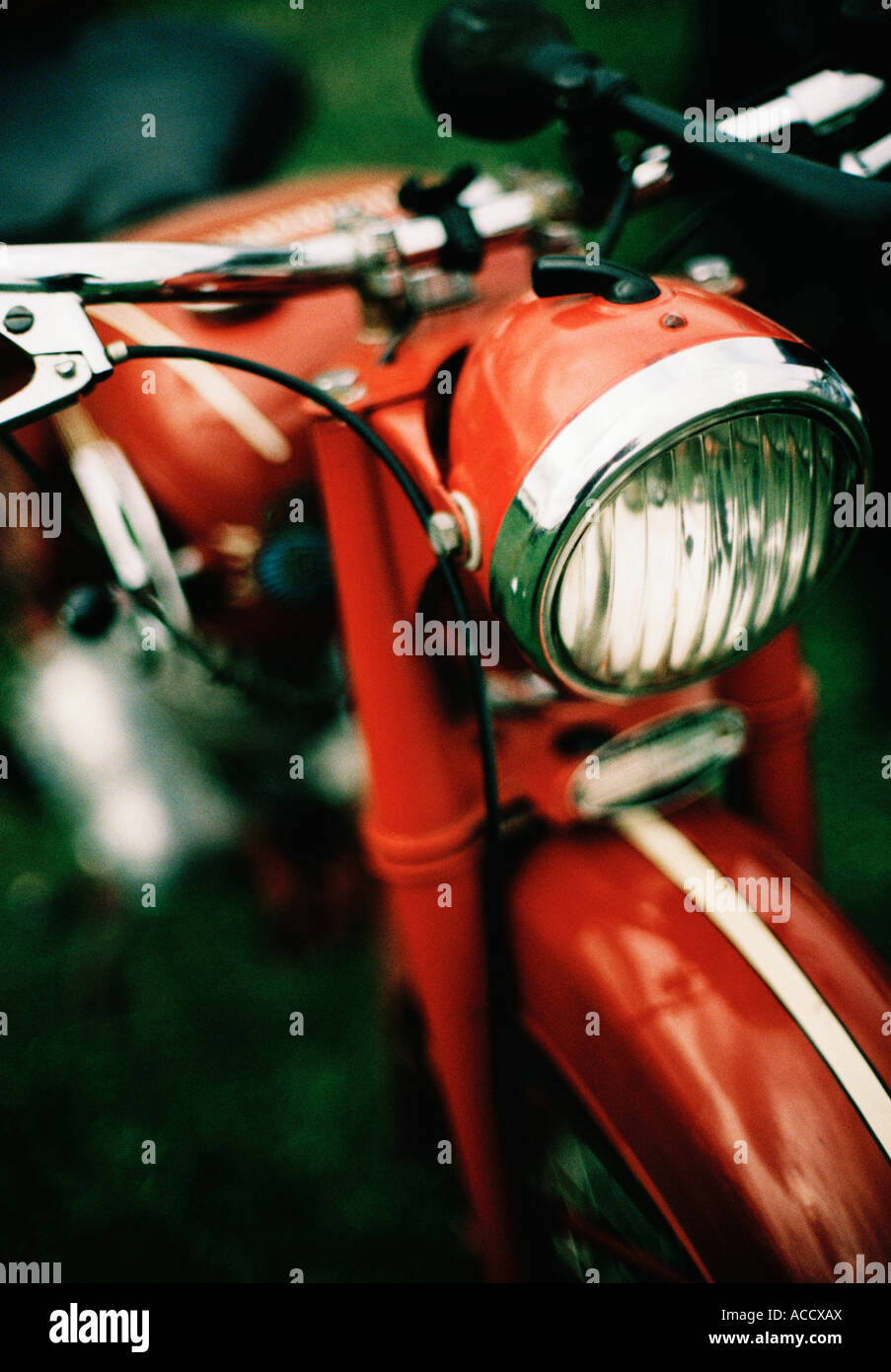 A red Husqvarna mooped. - Stock Image