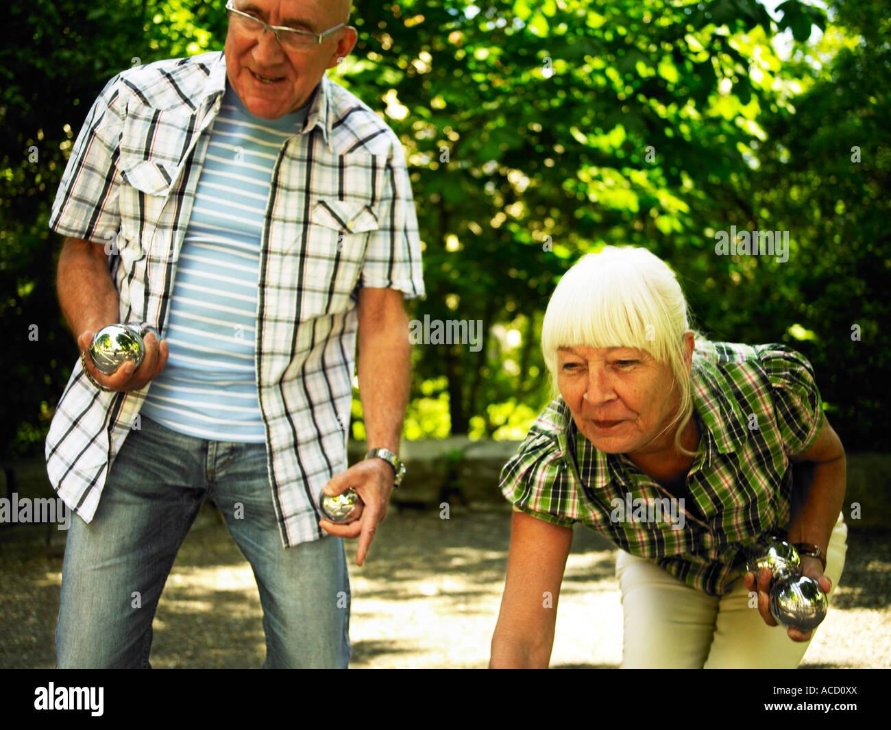 Senior citizen playing boule. - Stock Image