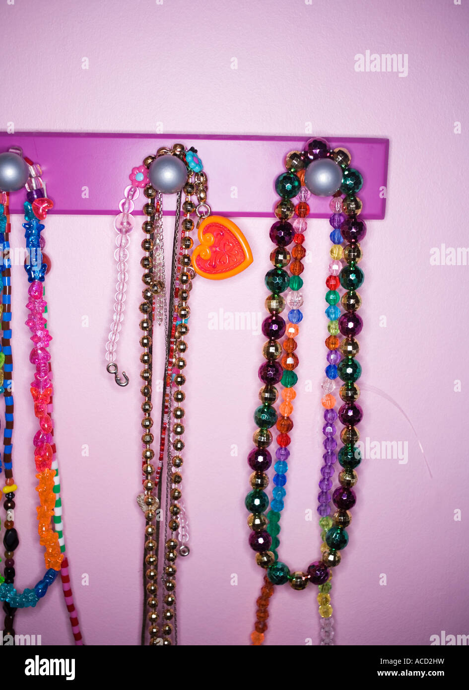 Necklaces on a hook in a childroom. - Stock Image