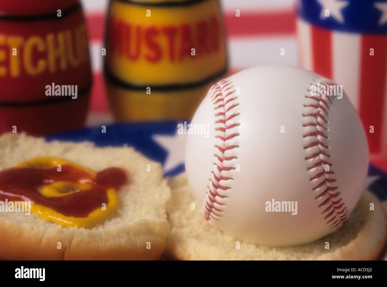 Baseball sitting on hamburger bun open faced with ketchup and mustard on bun Issaquah Washington State USA - Stock Image