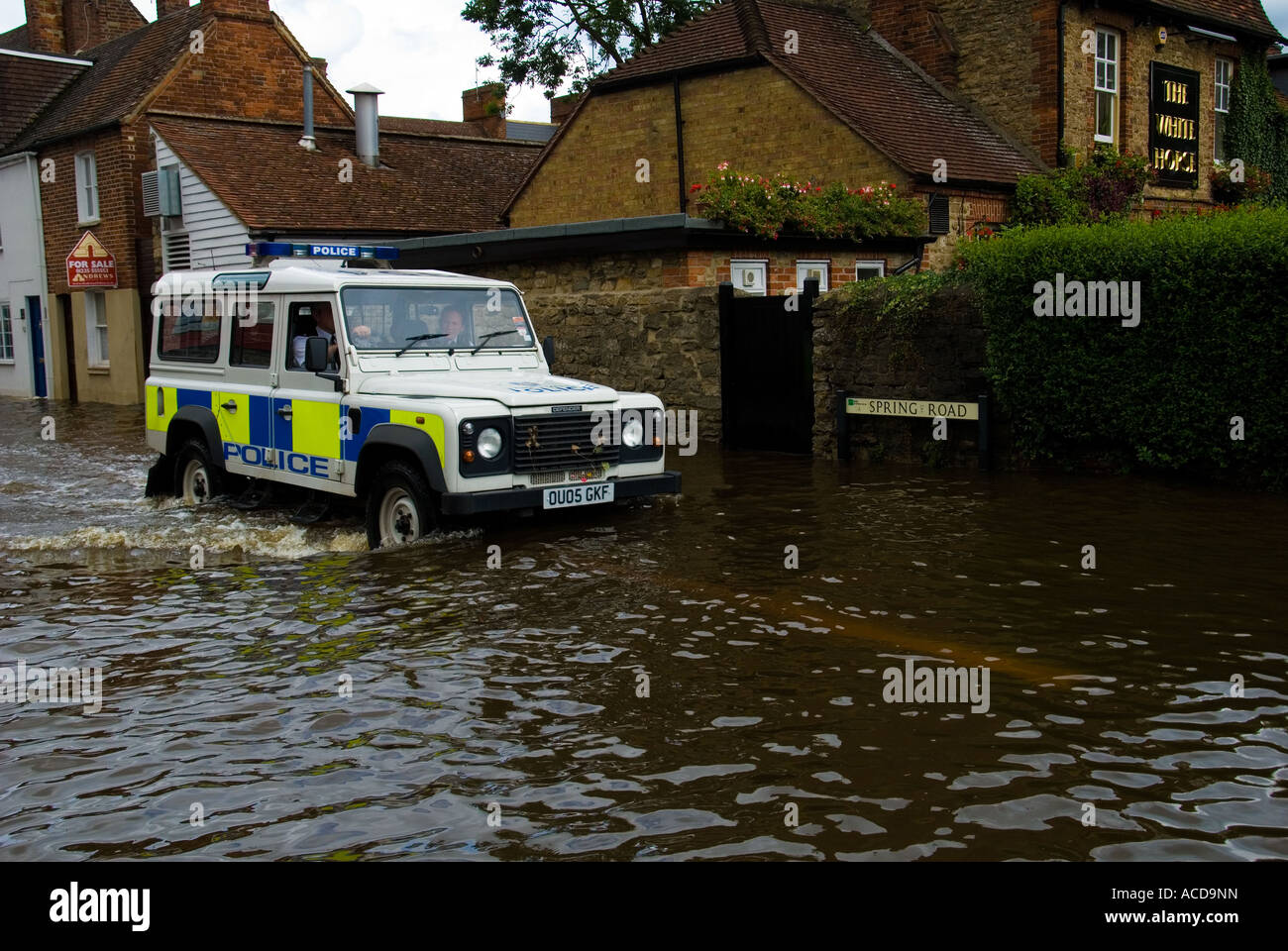 Police Land Rover Stock Photos Images Alamy Driving Light Wiring Australian Owners A Along Flooded Street Image