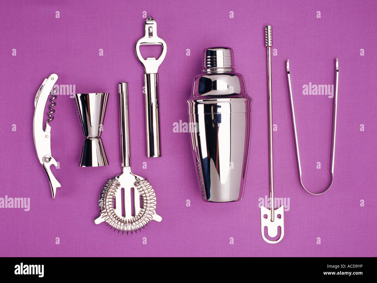 Kitchen utensils in stainless steel on a purple background ...