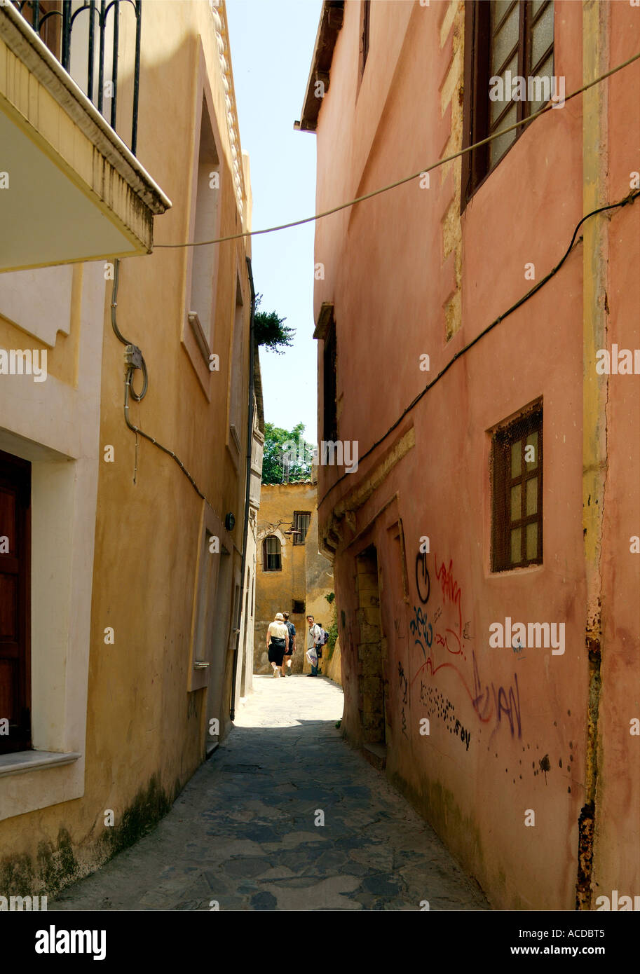 Two buildings leaning toward each other in narrow lane Chania Crete Greece - Stock Image
