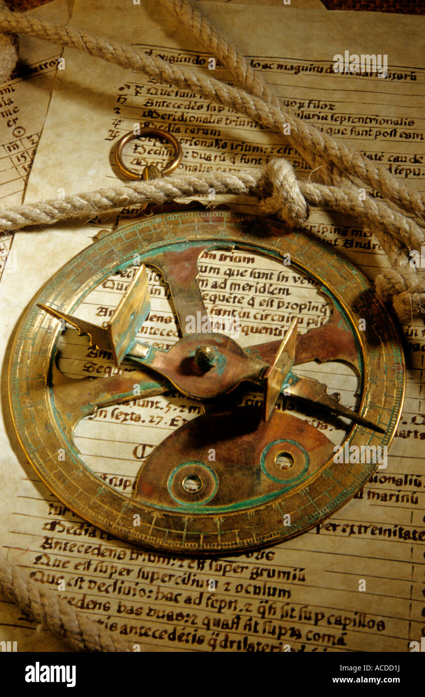 Historical navigation / sailing discovery - Antique sextant / sun dial on a chart log with rope - Stock Image