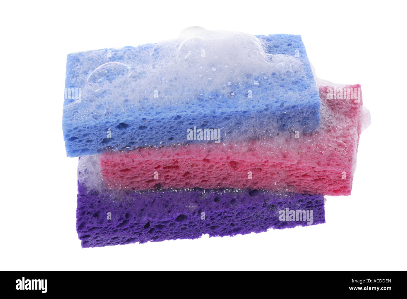 Sponges with soap suds cut out on white background - Stock Image