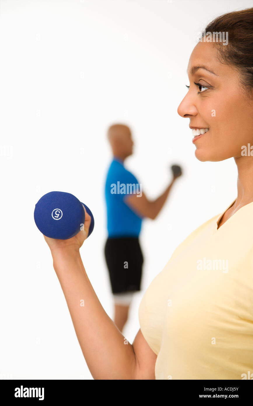 men women using dumbbells stock photos men women using dumbbells