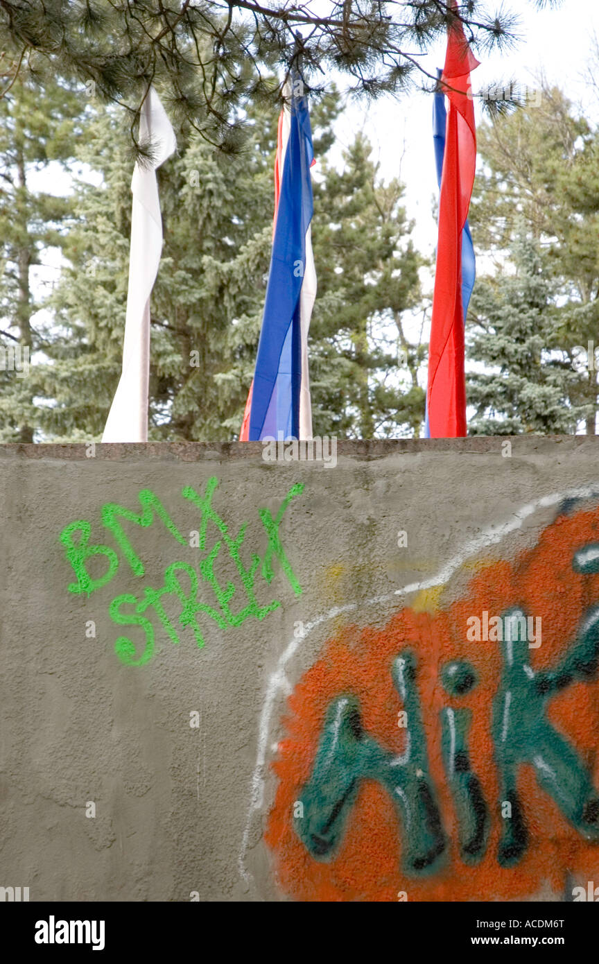 Graffiti mars the location of 3 flags symbolizing the colors of the Russian Federation - Stock Image