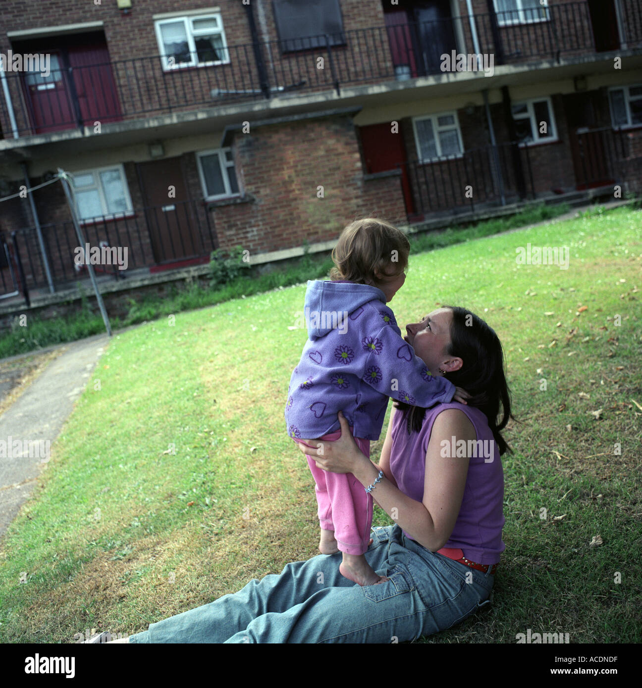 A young single mother with her daughter in a council estate, Bristol, UK. - Stock Image