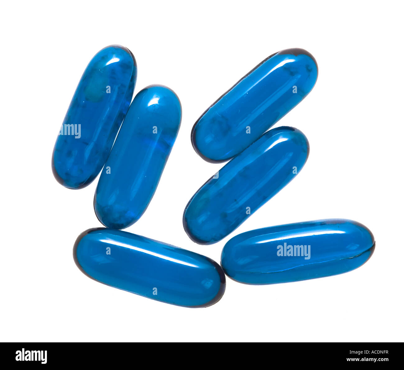 Old outdated flu treatment capsules with dark spots showing how contents are degenerating due for disposal UK - Stock Image
