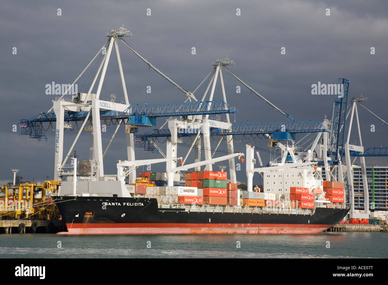 Auckland North Island New Zealand Container ship berthed by wharf in port on eastern waterfront from Waitemata Harbour - Stock Image