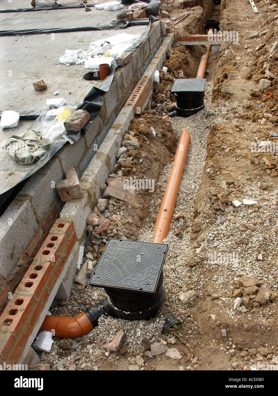 part of foul drainage system for new house with plastic pipes manhole shows bridging lintel