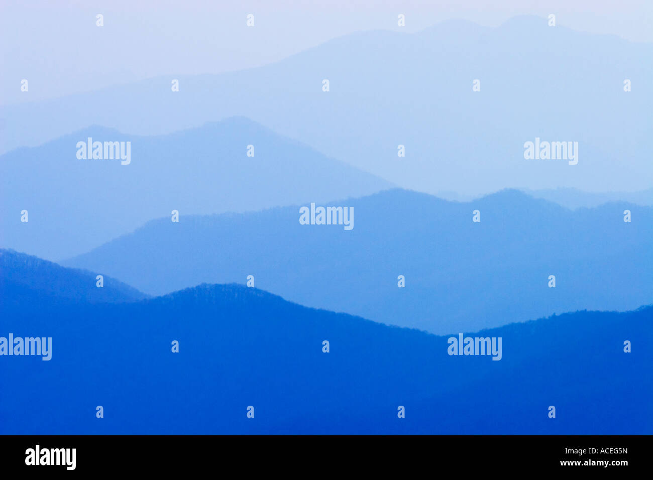 Hazy mountains prior to sunrise - Stock Image