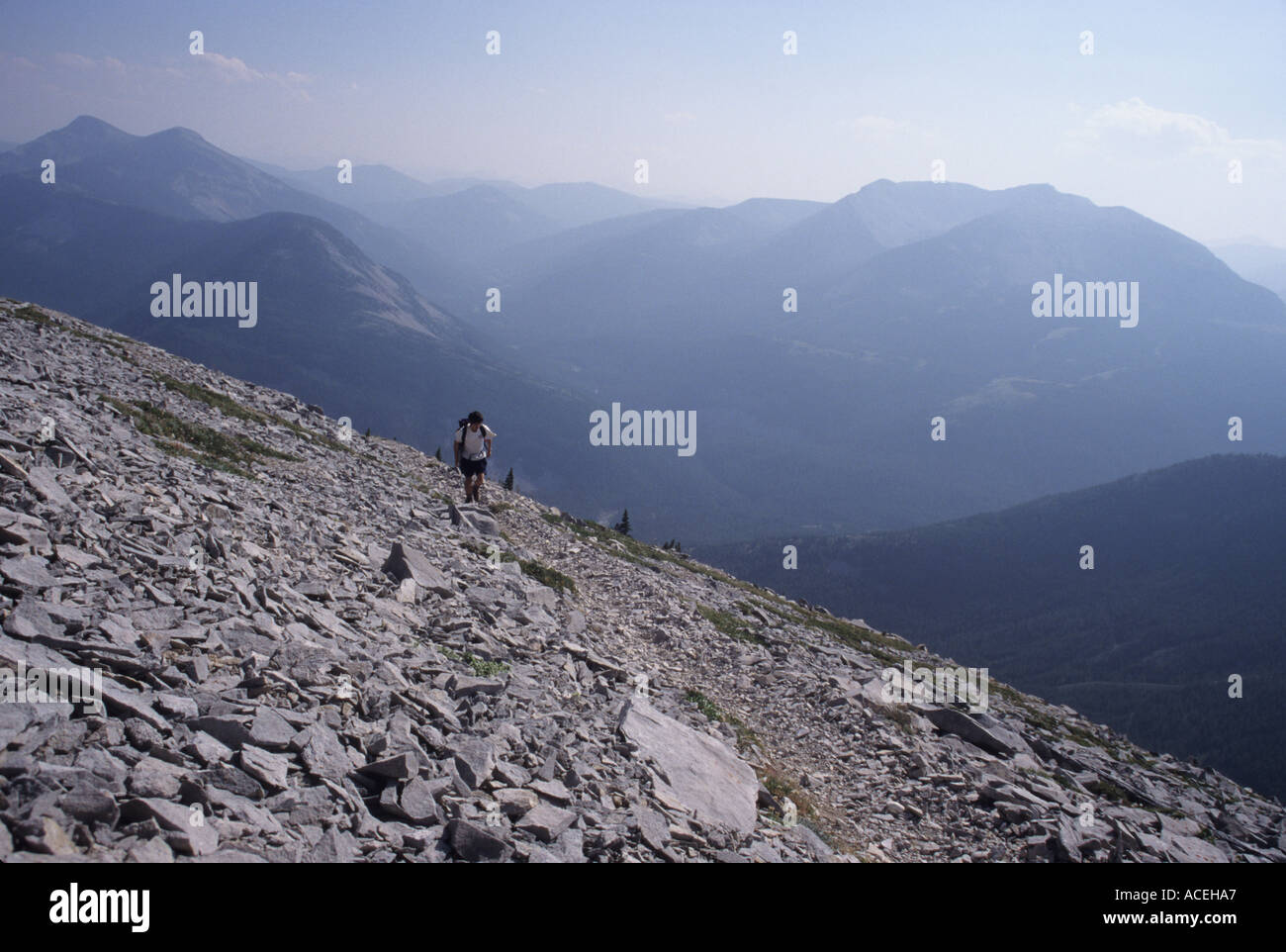 A hiker on the Half Dome Crag Trail in the Badger-Two Medicine roadless area of the Northern Rocky Mountains, Montana,Stock Photo