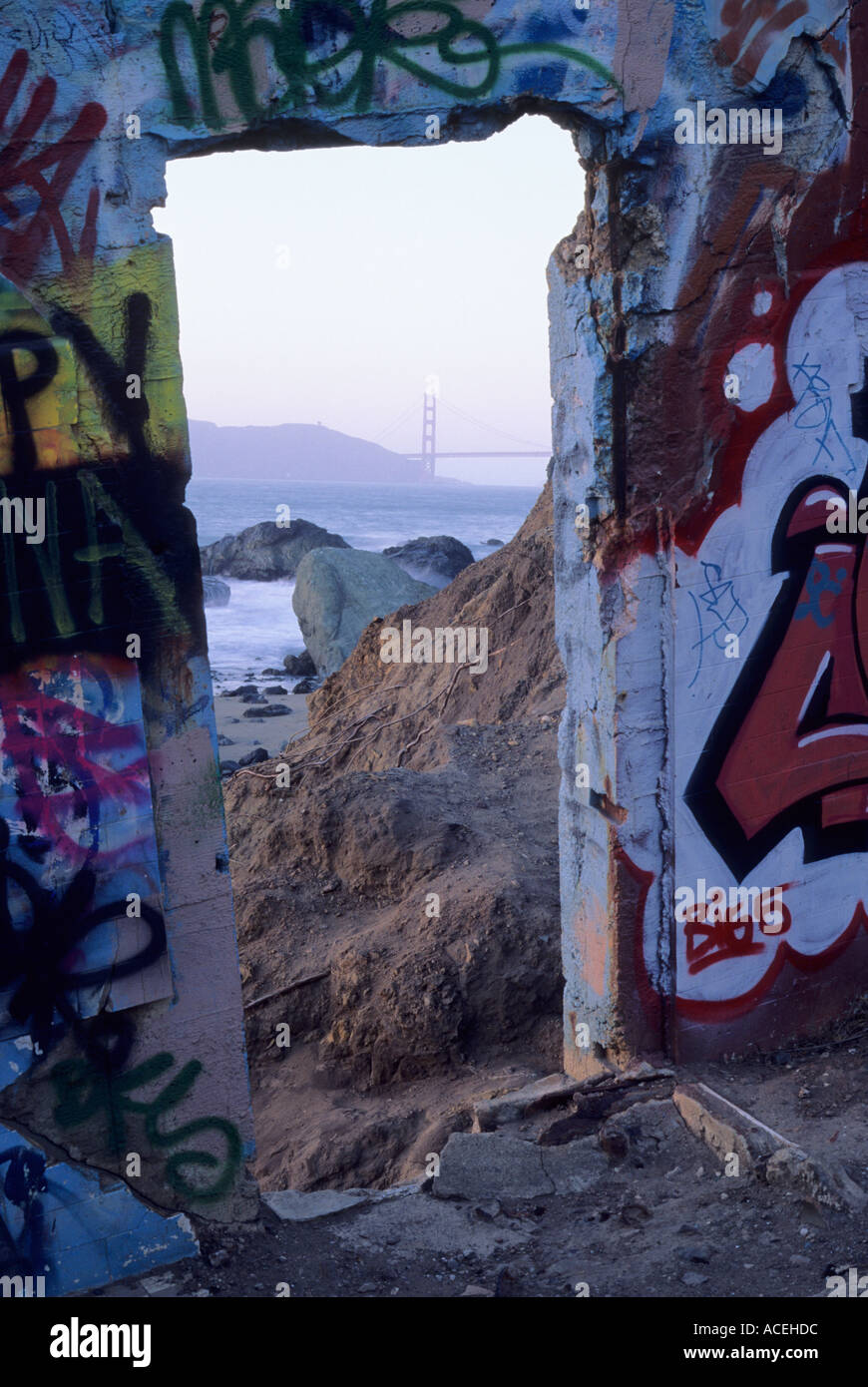 Golden Gate Bridge and old grafitti covered army structure, Land's End, GGNRA, San Francisco, California - Stock Image