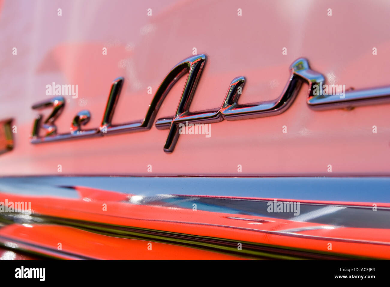 Close up the Chevrolet Bel Air label in chrome on a red and white classic car at an auto show - Stock Image