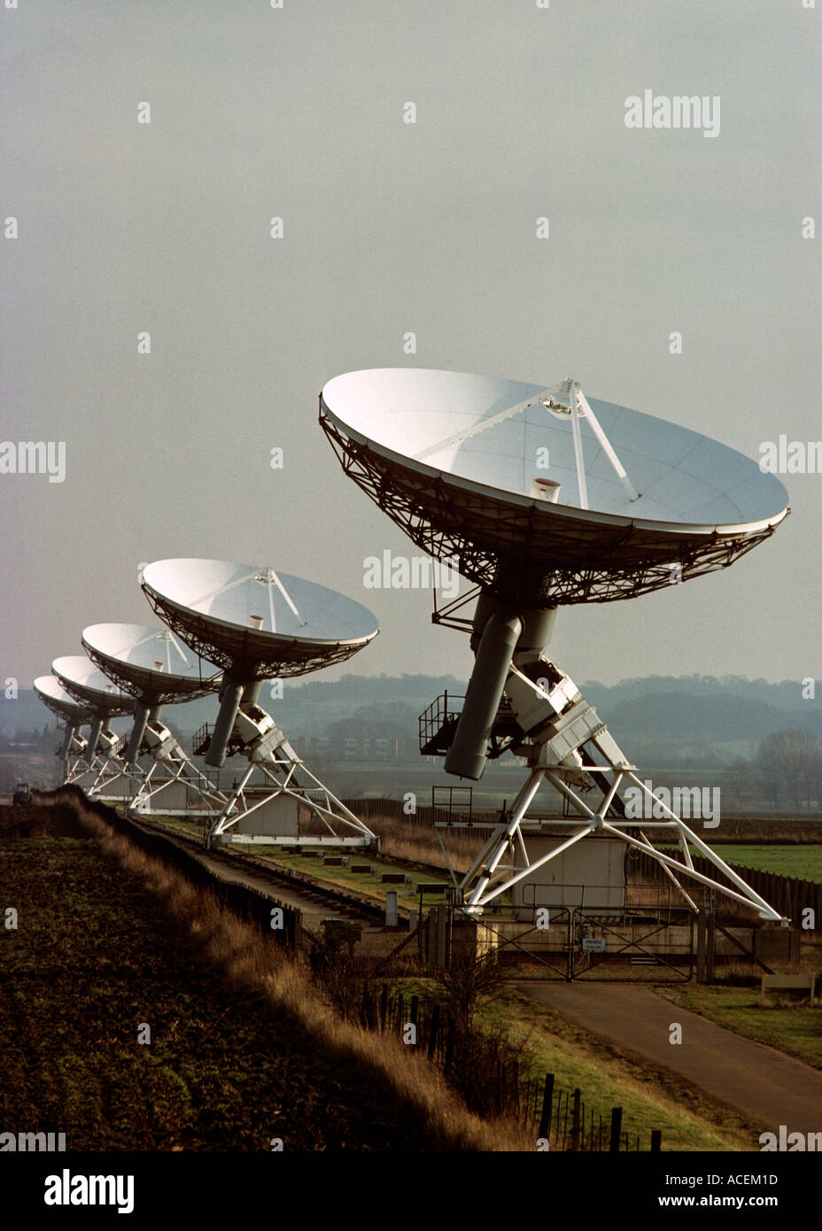 array of radio telescopes linked by rail and computer to create one big device Outside Cambridge - Stock Image